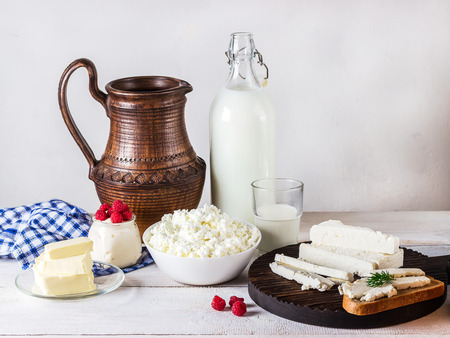 milk products: Dairy products on white wooden background. Style rustic. Selective focus.