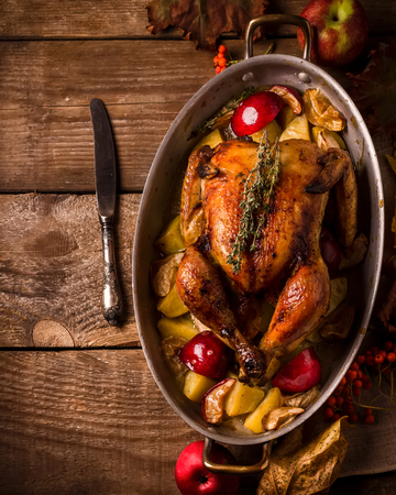 Served roasted stuffed Thanksgiving Turkey and  vegetables from above and blank space. Style rustic. Stock Photo