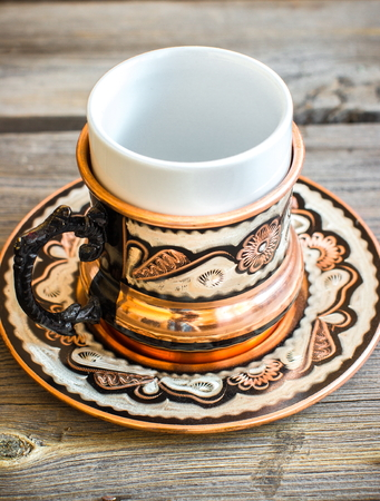 Cup in arab style  on wooden table. Selective focus.