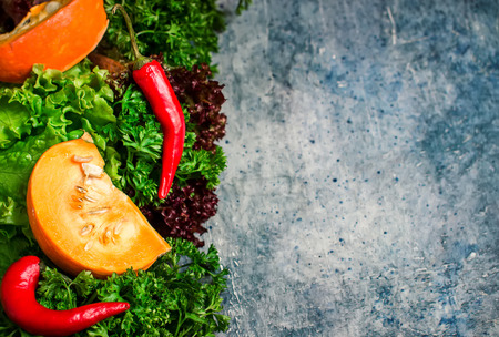 Autumn nature concept. Fall  vegetables on blue stone background. Selective focus. Place for text.
