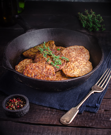 Fritters from a liver on dark wooden background. Style rustic.  Imagens