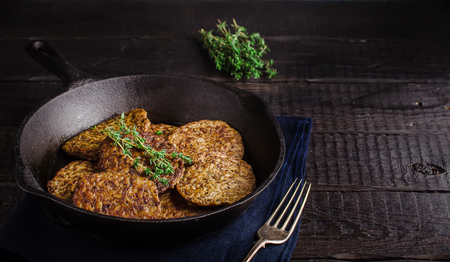 Fritters from a liver on dark wooden background. Style rustic.