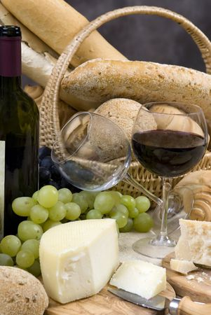 chianti: Two glasses of chianti wine with assorted breads and cheeses