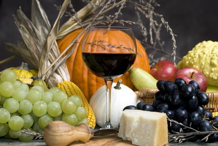 Autumn fruits with wine and cheese photo