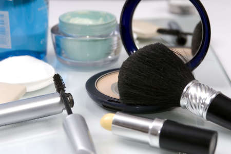 A womens makeup is sitting on a table waiting for the evening events.
