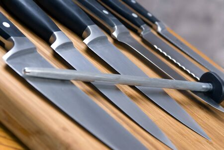 sharpen: A set of high quality kitchen knives on a cutting board