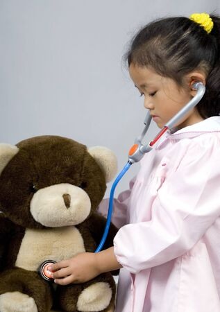 A young girl cares for her sick bear Stock Photo - 623876