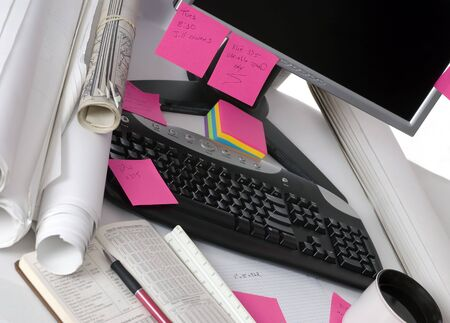 The desktop of an engineer littered with the tools of the trade Stock Photo - 584817