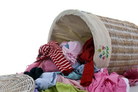 A pile of diry clothes overflows from a young girls laundry basket.... a never ending supply.