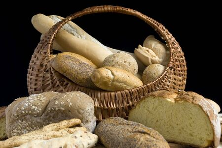 An assortment of breads on a black background photo