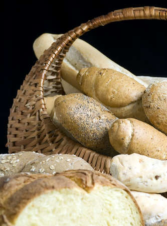 An assortment of breads in a basket with a black background Stock Photo - 623874