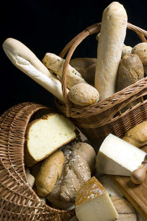 cheeses: An assortment of hard cheeses and breads