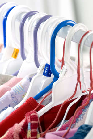 designer baby: Toddler clothes hanging in the laundry room. Close up