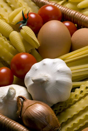 close up of onions in a basket: All the ingredients for a great pasta... Italian style Stock Photo