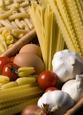 close up of onions in a basket: All the ingredients for a great pasta.... Italian style