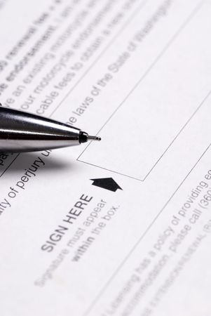 project deadline: A pen sits ready to sign in the block Stock Photo