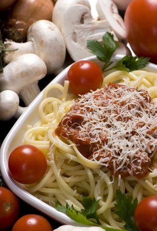 Fresh spaghetti and sauce, surrounded by all the ingredients Stock Photo - 623820