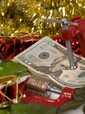 indebt: The holidays always put a squeeze on you money Stock Photo