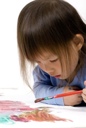 masterpiece: A young girl painting her masterpiece on the floor
