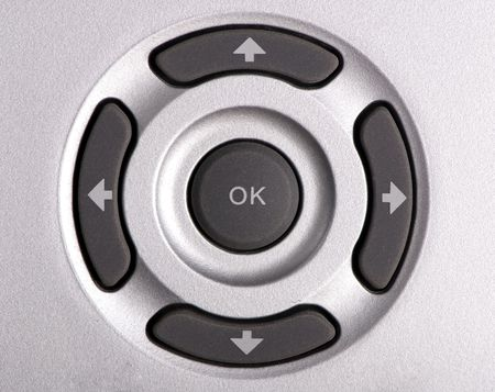 vcr: A macro shot of the directional control of a remote control