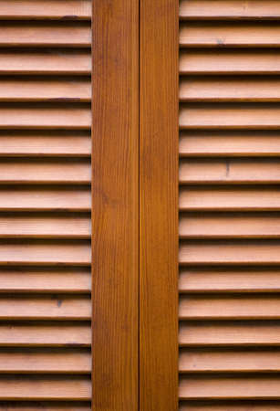 lattice window: A close up shot a beautiful stained wooden shutters on a window