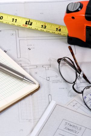 Engineering drawings and tools laid out on a table 版權商用圖片 - 646960