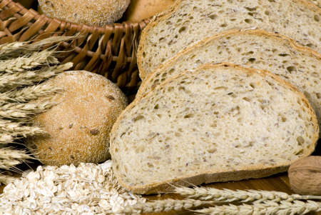 An assortment of whole grain wheat breads on a table. Stock Photo - 646956