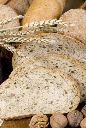 An assortment of whole grain wheat breads on a table. Stock Photo - 646902