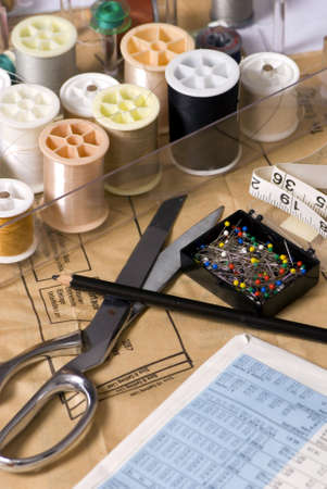 sewing supplies: Sewing supplies are laid out on a table for a new project