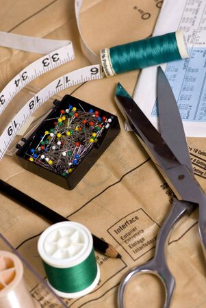 sewing supplies: Sewing supplies are laid out on a table for the next project