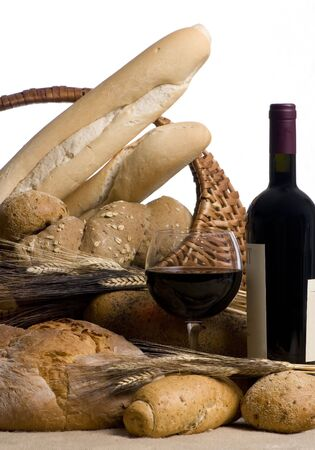 A glass of red wine with an assortment of breads isolated on white Stock Photo