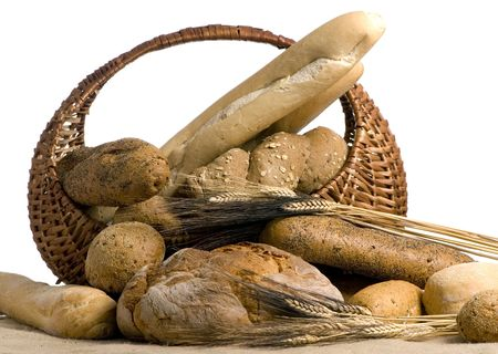 An assortment of fresh breads in a basket isolated on a white background Stock Photo - 670505