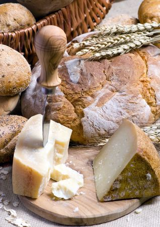 An assortment of cheeses and breads make an inviting view Stock Photo - 683310