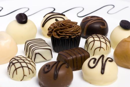 satisfying: Delicious chocolates and truffels await your arrival Stock Photo