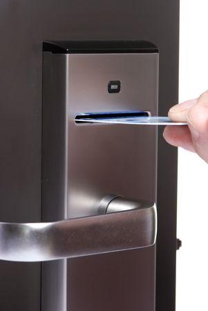 hotel room door: A modern door lock with a card swipe