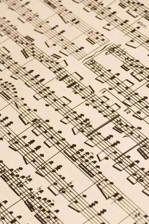 slightly: A very complicated musical score, slightly yellowed with age