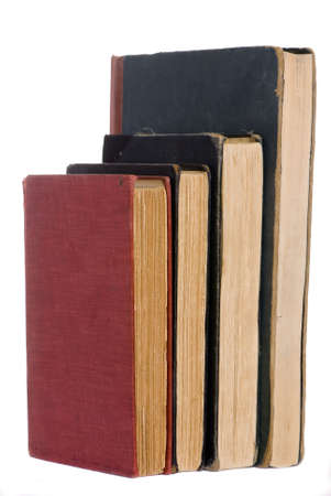 A stack of old books with worn covers photo