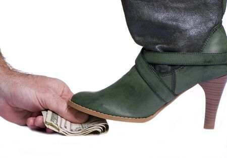 disgrace: A person giving money for something less than legal...a y boot steps on top of it.