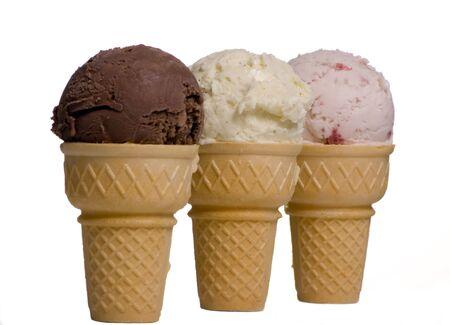Three different ice cream cone in a row...chocolate, vanilla, and strawberry