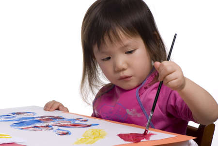 masterpiece: A young asian girls paints her masterpiece Stock Photo