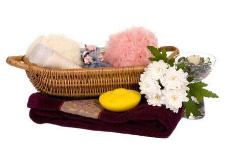 A beautiful layout of towels and lotion with a candle. Perfect for your spa treatment. photo