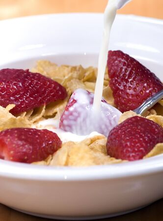 A healthy start to a day with cereal with fresh strawberries photo