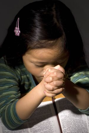 moment: A young asian girl spends a moment to be thankful for everything in her life