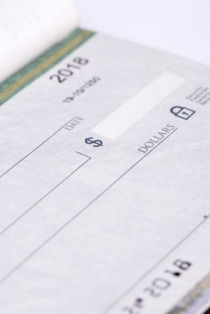 blank check: An open checkbook with a blank check