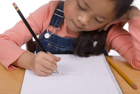 A young girl writes letters in a notebook Stock Photo - 760949