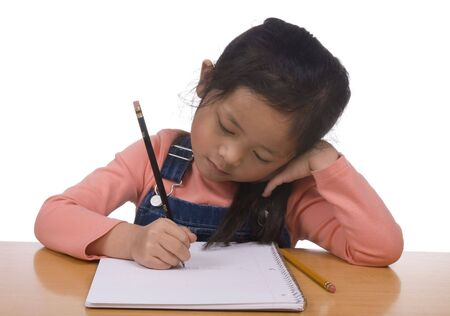 A young girl practices her writing... first letters Stock Photo - 760946