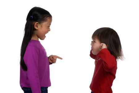 Two sisters having a slight disagreement. Big sister is yelling loud and little sister is about to lose it.