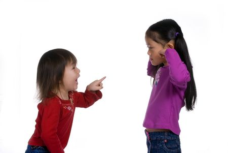 playmates: Two sisters arguing, but big sister isnt listening. Stock Photo