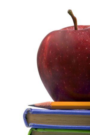 幼い頃教師のリンゴと本の山