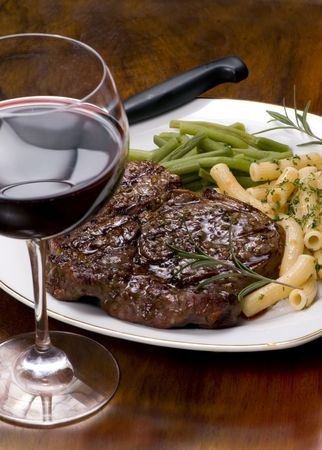 rib eye: A juicy Rib Eye steak dinner with red wine